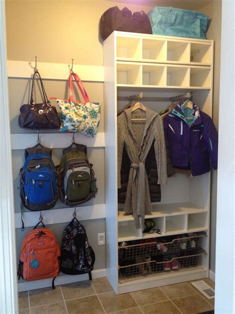 entryway backpack storage mud room i like that coat rack idea for the old tv hutch