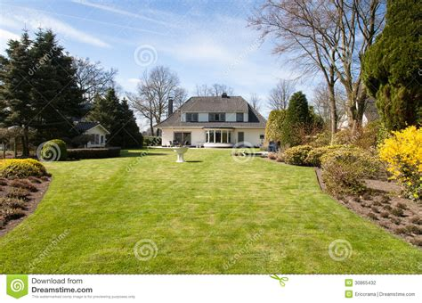Exceptional Houses With Big Backyards #1: Villa-big-yard-luxurious-country-house-freshly-mowed-lawn-under-blue-sky-spring-30865432.jpg