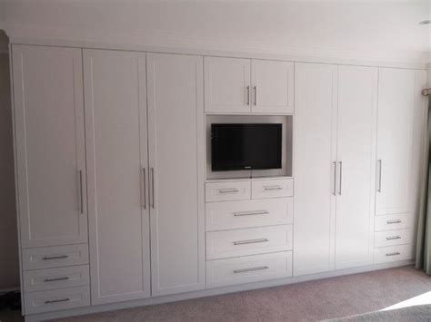 white bedroom cupboards  stylish television built