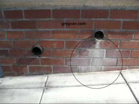 Wall Planter poor planter drain pipe location brick wall stains and