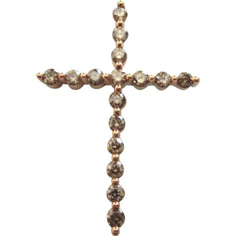 sleek 10k gold chagne cross pendant from