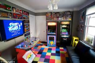 Meet the game obsessed man who spent over 32 000 turning his bedroom in a 1980s style arcade