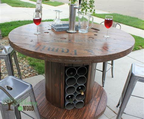 cable reel table cable reel up cycled pub height table with draft tower wine storag whimsy and wood