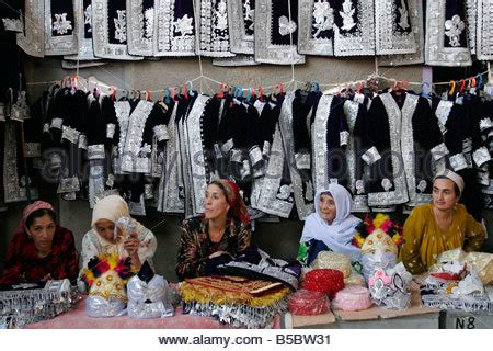 uzbek women selling traditional wedding skullcaps and dresses sunday uzbek woman selling traditional wedding skullcaps and