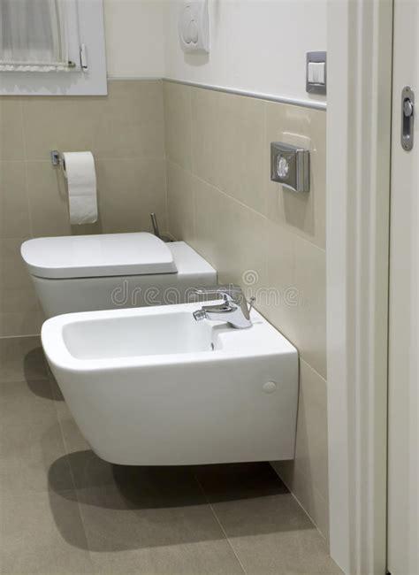 bathroom suites with bidet toilet and bidet in hotel bathroom royalty free stock