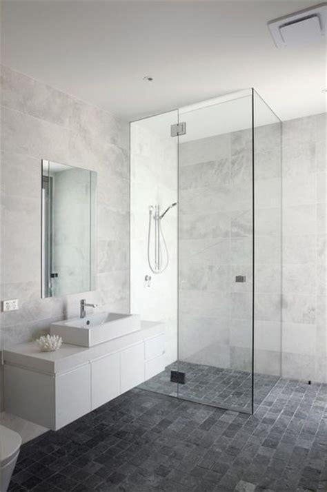 Bathroom: white/grey marble look wall tiles, dark grey