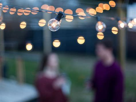 how to hang outdoor lights how to hang outdoor string lights from diy posts hgtv