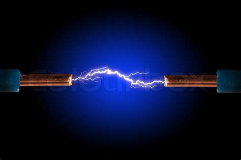 electric cable with sparks on a black background stock
