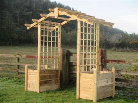Wooden Garden Arch With Planters by Wooden Garden Arch With Attached Planter Boxes