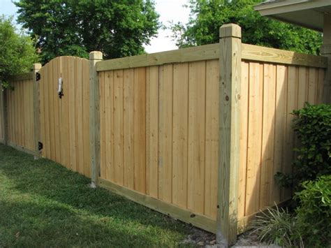beautiful new capped wood fence gate design by mossy oak fence company orlando fl wood