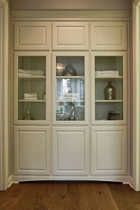 floor cabinet with glass doors burrows cabinets bathroom floor to ceiling linen cabinets
