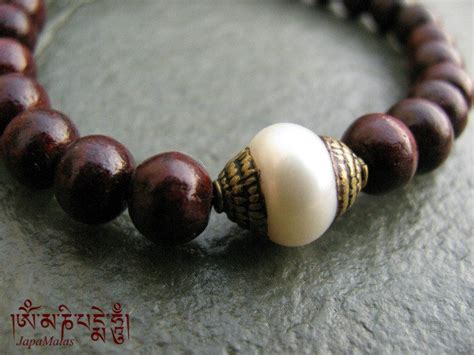 what is a guru bead rosewood bracelet mala with capped pearl guru bead