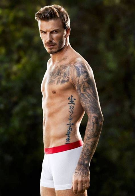 beckham tattoo ribs meaning running down david beckham s left rib cage he got a large