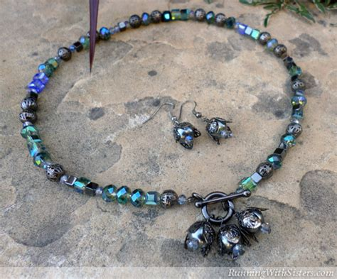 bead a bead a necklace and earrings with black pearls and