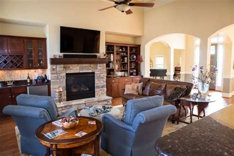 great room  stone fireplace built  bar bookcase