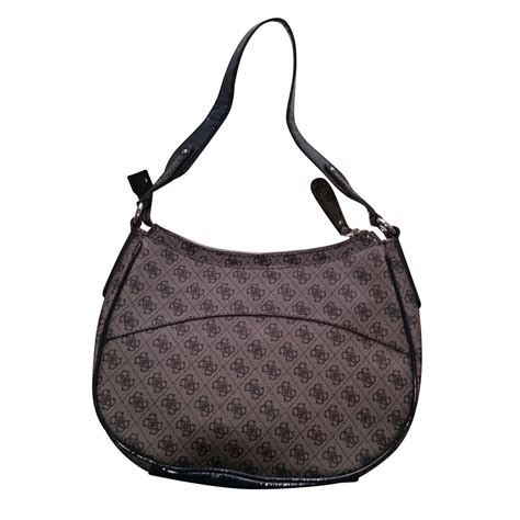 Other Designers Guess Who Hiding The Designer Bag by Guess Handbags Handbags Cloth Other Ref 5791 Joli Closet