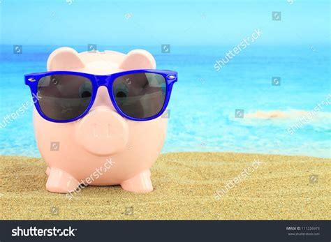 summer bank summer piggy bank sunglasses on stock photo