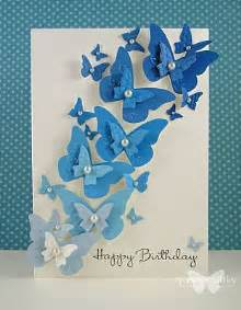 beautiful handmade card swarm of punched butterflies in blue like the dimension