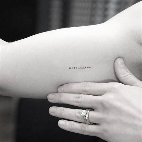 small date tattoos minimalist date in numerals on the right