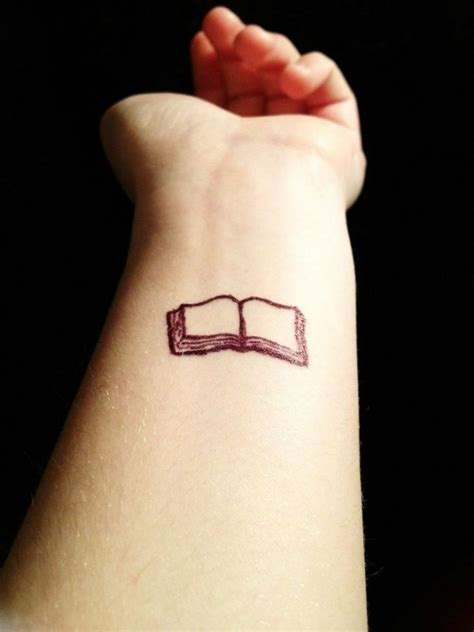 minimalist tattoo book small and pretty book tattoo on arm tattoomagz