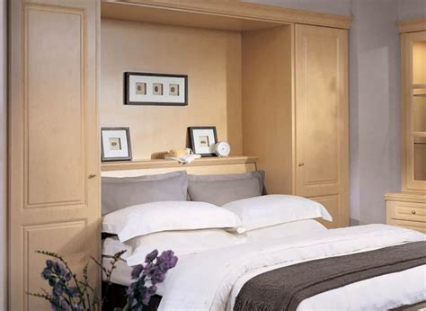 wall fitted headboards fitted hidden bed storage in bedroom with maple wood