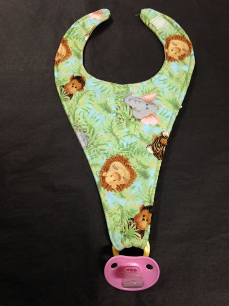 pattern for pacifier holder bib items similar to handmade jungle print bib and pacifier