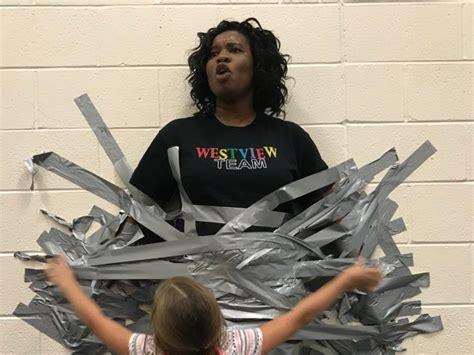 students duct tape principal  school wall  good