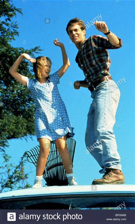 lawn dogs mischa barton sam rockwell lawn dogs 1997 stock photo royalty free image