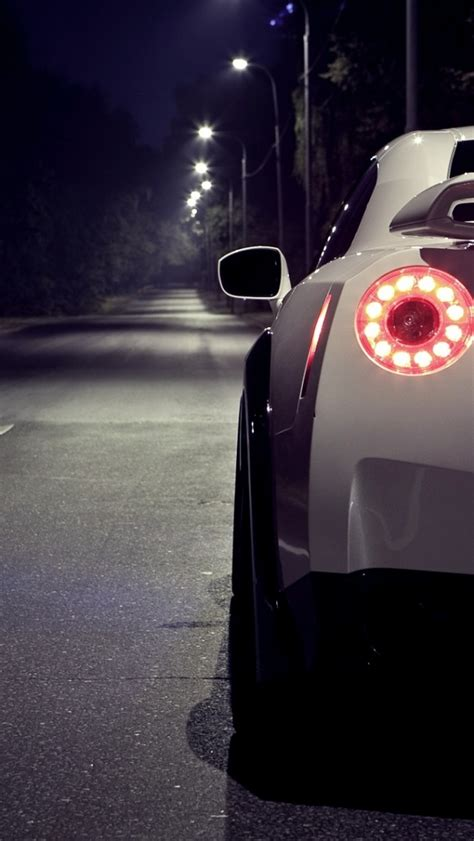 wallpaper for iphone 6 gtr 640x1136 white nissan 35 gtr at night rear section iphone
