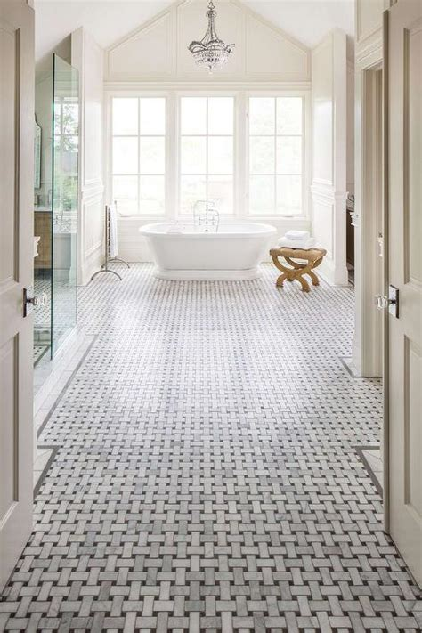 basketweave tile bathroom master bathroom with high ceiling and marble basketweave floor transitional bathroom