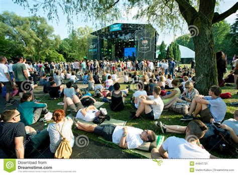 backyard party song people sit on the grass and have rest on outdoor party of
