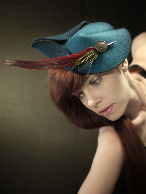 teal fascinator hat teal felt fascinator with red and green feathers diana