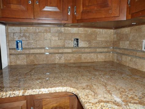 limestone backsplash kitchen granite subway tile backsplash white glazed cabinets