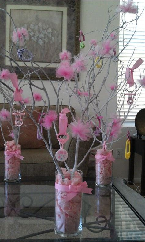 tree branch centerpieces diy tree branch centerpiece w baby toys pompoms if you are working w a budget here s a