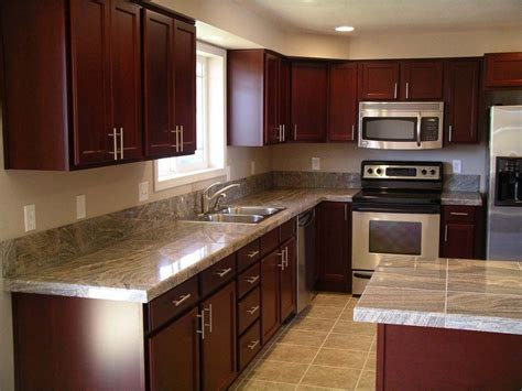 dark kitchen cabinets with light granite countertops dark cherry cabinets with granite countertops home
