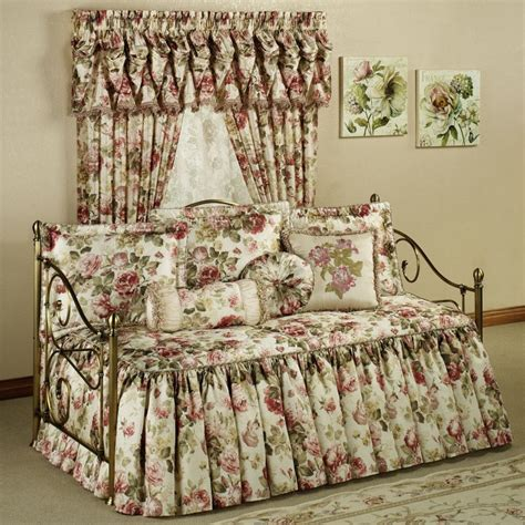 Golden red long curtains combined with cream red comforter bedding set placed on the black bed