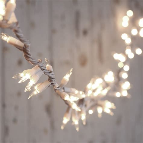 clear bulb and white cord cluster string lights lighting