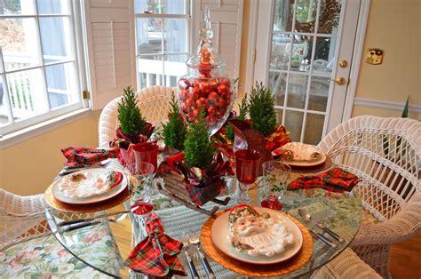 table santa santa themed tablescape with santa plates and a sleigh