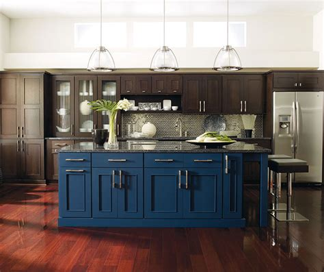 metropolitan home kitchen design dark wood cabinets with a blue kitchen island omega