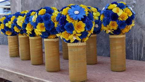 blue and yellow centerpieces royal blue and yellow wedding bouquets pomanders