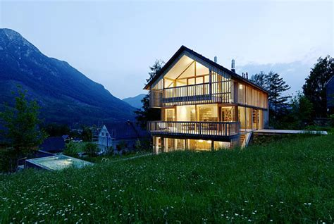 wood and glass mountain house with trio of terraces modern house designs