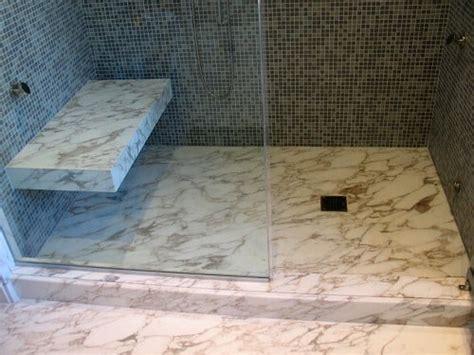 how to build a floating shower bench custom calacatta slab floor vein match shower curb
