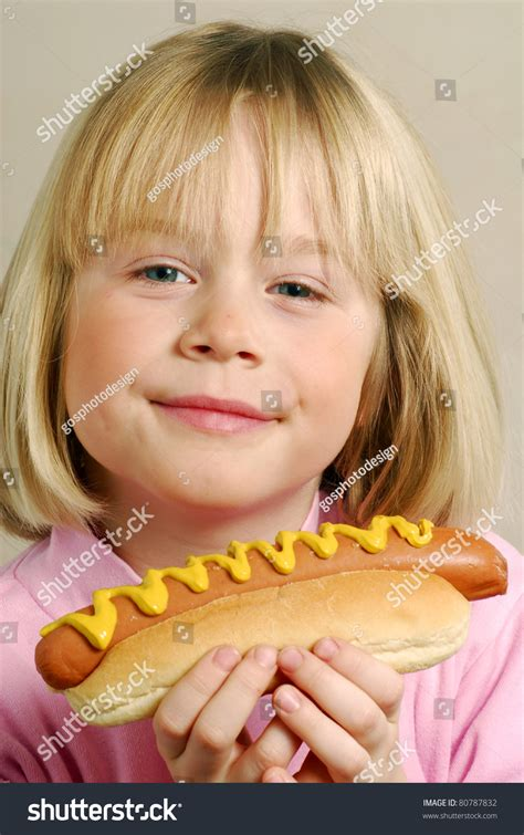 female hot dog eating chion little girl eating hot dogkid eating stock photo 80787832