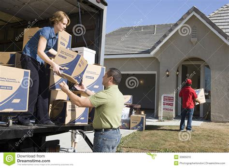 moving into a new house couple unloading moving boxes into new house stock photo image 33905010