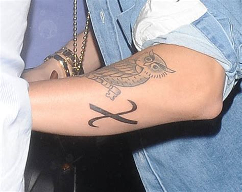 justin bieber tattoo x significado justin bieber s quot x quot greek christ symbol tattoo on his arm