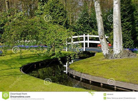 garden footbridge footbridge in spring garden royalty free stock images
