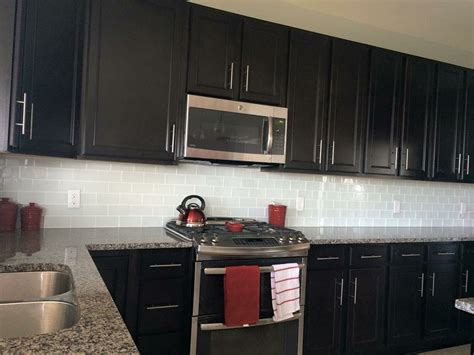 backsplash goes black cabinets home white glass subway tile backsplash with cabinets