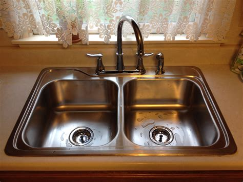 how to unclog a double kitchen sink with standing water