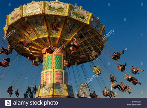 spinning swing ride children on the classic spinning swing ride at sunset at