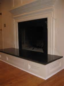 how to build a raised fireplace hearth raised paneled fireplace with granite surround and hearth